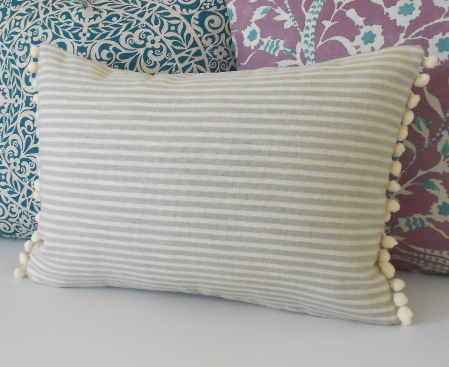 Tan and cream small stripe decorative pillow cover with pom