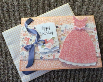 Handmade birthday card with dress & ribbon and matching envelope.