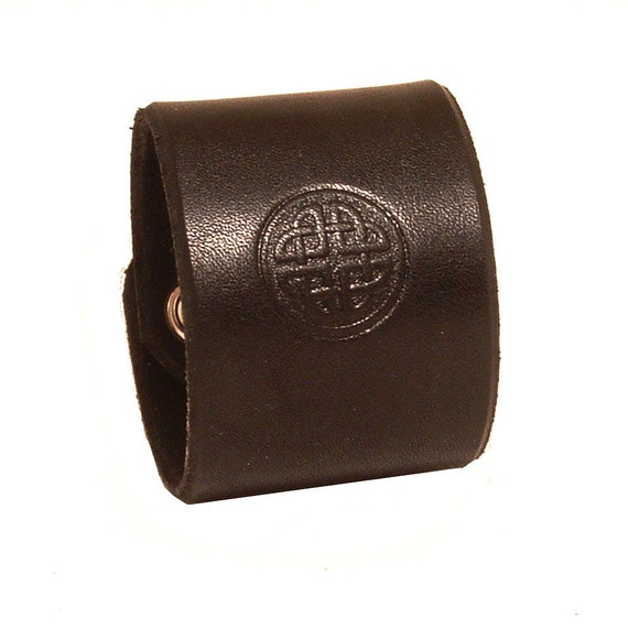 Embossed leather bracelet with Celtic pattern.
