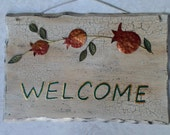 Aged wooden welcome sign outdoor decor  metal work  pomegranates