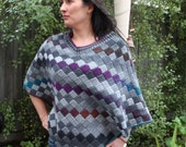 Crochet pattern for an Entrelac poncho using a simple tunisian stitch and a standard crochet hook.