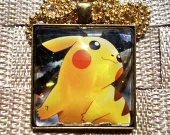 1.5 Diameter Pikachu HOLO Handmade Glass Pendant from Trading Cards