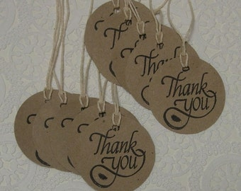 Kraft Paper Thank You tags, 2.5 inch die cut circles, punched, tied with natural twine