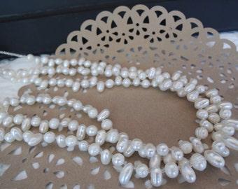 Freshwater Pearls Triple Strand Dainty