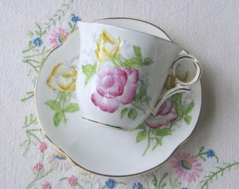 Vintage Victoria bone china tea set with hand painted pink and yellow roses