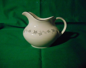 One (1) 12oz Creamer, from Royal Doulton, in the Cadence Pattern.