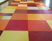warm colored floorcloth with reds, oranges, and yellows