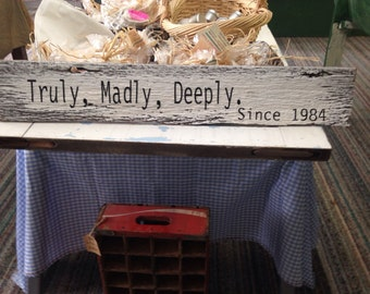 Truly, madly, deeply love sign with established date on barnwood