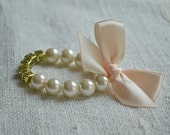 CUSTOM NAME - Adorable Pearl Name Bracelet with Satin Bow - Ivory pearls, Blush ribbon - silver or gold letters