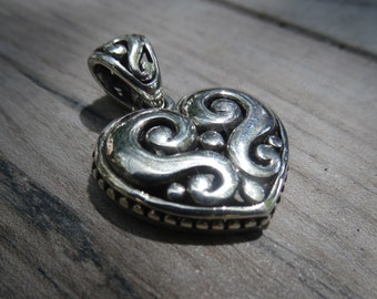 Vintage sterling silver heart with matching pendant bail.