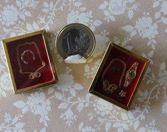 Dollhouse miniature gold jewels under theca