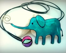 Elephant with a ball handmade necklace!!German silver , resin , leather thread!!