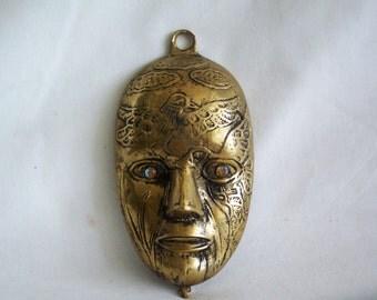Masquerade, Vintage brass ornate wall hanging Venetian mask. Mardi Gras, Carnival, masked ball, bal masqué, theater, decor
