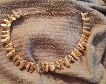 Vintage gold tone necklace with green stones