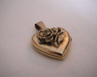 Very old gold-tone rose locket