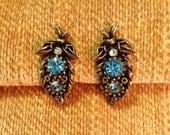 Signed Coro designer clip earrings aqua blue rhinestones gold tone metal setting mid century retro designer costume jewelry