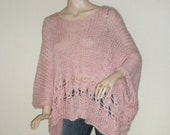 This pink knitted poncho is very very soft,warm and light.