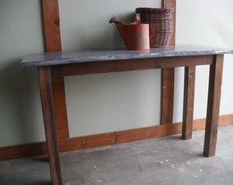Metal top table made from reclaimed wood