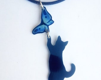 Playful Black Cat Chasing Blue Butterfly Whimsical Dangling Pendant Metal Necklace