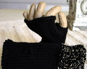Hand Knitted Fingerless Gloves.  Black with a gold and black tweed on the cuffs.  Can be worn inside out for a different texture.