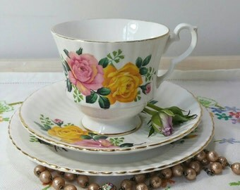 Vintage bone China Teacup trio, tea cup, saucer and side plate made by Royal Windsor China with pink and yellow roses and gold gilding.
