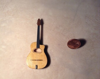 Miniature guitar made of basswood. Scale 1/12