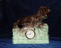 Porcelain clock with lion