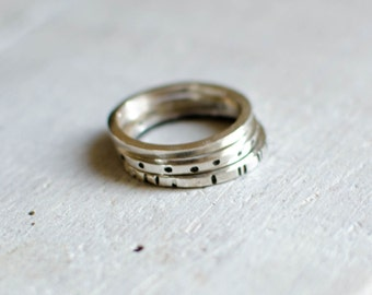 solid silver ring has l ' unit, custom, minimalist, graphic, discete, ring a stack, black and white