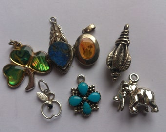 lot of seven small pendants/charms