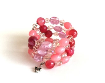 Memory wire bracelet, pink, coral, and berry with fleur de lis charms