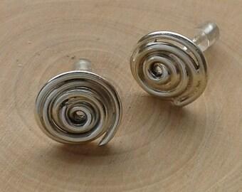 Swirly silver earstuds