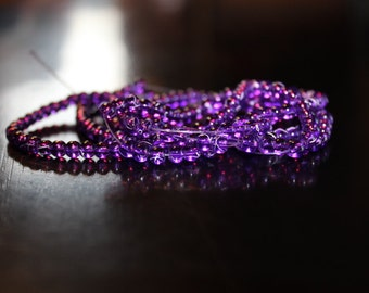 195 approx. 4 mm drawbench transparent glass beads, purple, with spray painted white lines, hole 1.1-1.3 mm