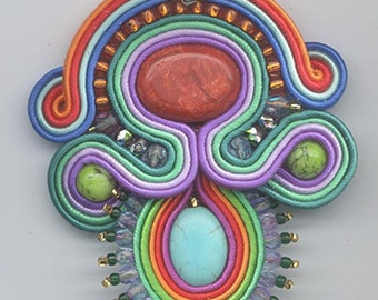 Necklace and earriing set showcasing a fantastic soutache pendant
