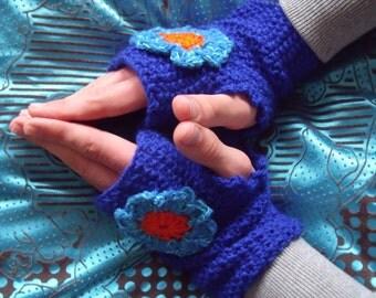 Blue fingerless gloves with crochet flower