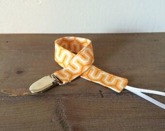 Orange Geometric Pacifier Clip