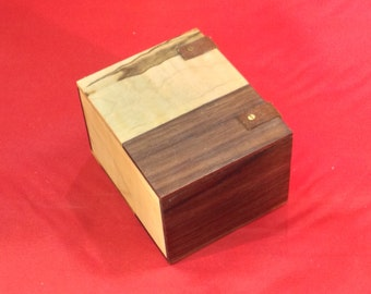 Small wooden box with leather hinges