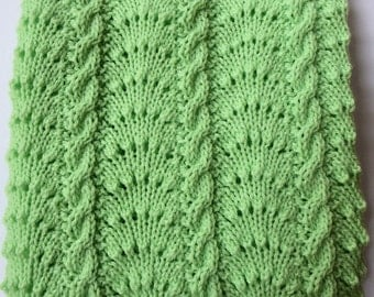 Baby Blanket hand knitted in a beatiful Mint Green colour. Comfortable and warm.