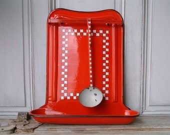 Vintage french enamel utensil rack with ladle. Red with white check Lustucru frieze. French country. Rustic farmhouse. French kitchen decor