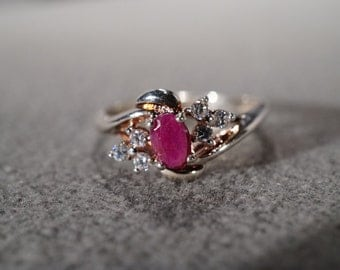 vintage sterling silver fashion ring with oval ruby set off with six round white sapphires, size 10    M7