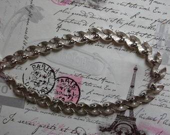 silver coloured necklace