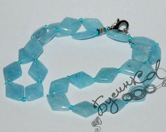 Aquamarine rhombus beads.