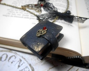 Bronze-colored necklace with book handcrafted from polymer clay