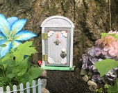 """Hinged """"flowered"""" Fairy door for the home or garden - cloud grey"""