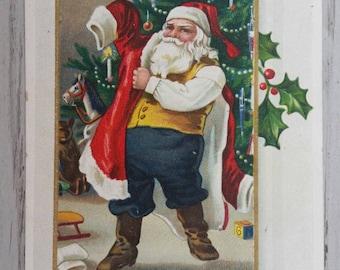 Santa Putting on His Coat Christmas Greetings Postcard Vintage Printed in Germany