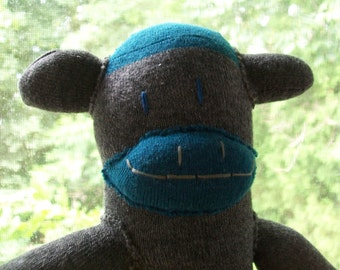 Gray and teal sock monkey