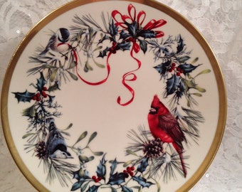 Winter Greetings by Catherine McClung from the Wreaths of the Month Plate Collection, DECEMBER, 1994, Cardinal, Nuthatch and Chickadee.