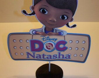 Two for 20.00 Doc McStuffins Centerpieces mounted on wood base Single sided