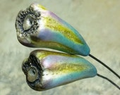 Polymer clay headpin drops. Flower bud shaped with organic textures in shades of blue-green, and yellow