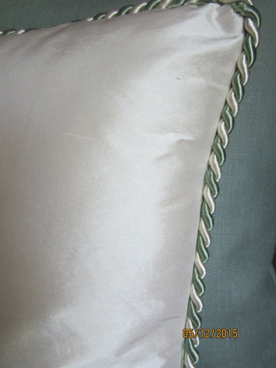 Ivory silk satin throw pillow with green and white twist cording 16 inch square