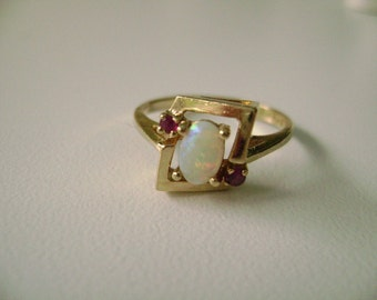 10k yellow gold opal and ruby ring, opal and ruby ring, 10k gold opal ring, 10k gold ruby ring, rubies and opal ring, yellow gold ring, 10k